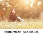 pretty thai girl at the park | Shutterstock . vector #585206626