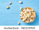 sweet popcorn in a yellow bowl... | Shutterstock . vector #585219935
