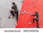 two climbers compete in a...   Shutterstock . vector #585240056