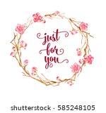 watercolor spring flower wreath.... | Shutterstock . vector #585248105