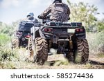 back view of quad bike  zipping ... | Shutterstock . vector #585274436