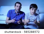 father and son are playing... | Shutterstock . vector #585288572