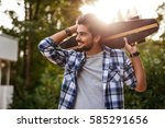 young man walking down the... | Shutterstock . vector #585291656