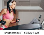 attractive woman doing cardio... | Shutterstock . vector #585297125