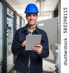electrician using a tablet in a ... | Shutterstock . vector #585298115