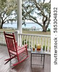 red rocking chair and table... | Shutterstock . vector #585304832