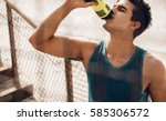 man drinking water after... | Shutterstock . vector #585306572