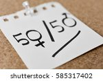 text 50 50 written in a piece... | Shutterstock . vector #585317402