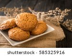 oatmeal raisin cookies on wood... | Shutterstock . vector #585325916