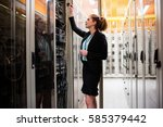 technician examining server in... | Shutterstock . vector #585379442