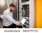 technician using laptop while... | Shutterstock . vector #585379715