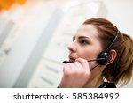 technician talking on headset... | Shutterstock . vector #585384992