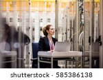 technician using laptop while... | Shutterstock . vector #585386138
