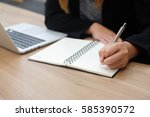 close up work woman writing on... | Shutterstock . vector #585390572