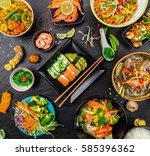 asian food served on black... | Shutterstock . vector #585396362