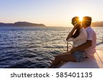 romantic couple on yacht at... | Shutterstock . vector #585401135