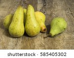 Small photo of Abate Fetel pears on wooden background