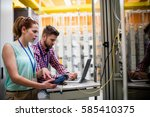 technicians using laptop while... | Shutterstock . vector #585410375