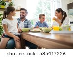 happy family interacting while... | Shutterstock . vector #585412226