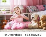 happy girl plays with magic... | Shutterstock . vector #585500252