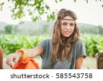 portrait of young hippie girl... | Shutterstock . vector #585543758