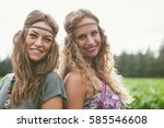 two young girls in hippie style ... | Shutterstock . vector #585546608