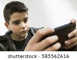 child with mobile phone | Shutterstock . vector #585562616