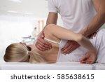woman having chiropractic back... | Shutterstock . vector #585638615