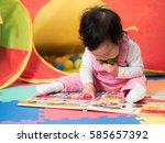 baby girl sitting on floor and...   Shutterstock . vector #585657392