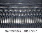 Black plastic pipes in a heap - stock photo