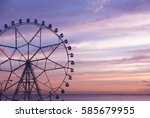 Ferris Wheel On A Sunset...