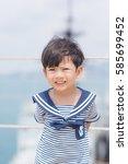 portrait of young sailor boy... | Shutterstock . vector #585699452