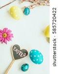 easter eggs  spring flowers and ... | Shutterstock . vector #585720422