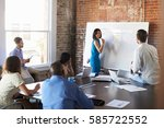 businesswoman at whiteboard in... | Shutterstock . vector #585722552