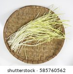 yellow leek on a bamboo basket | Shutterstock . vector #585760562