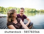 mature woman with adult son... | Shutterstock . vector #585783566