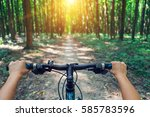 mountain biking down hill... | Shutterstock . vector #585783596