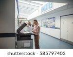 teacher is printing off work... | Shutterstock . vector #585797402