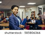 teen student is posing for the... | Shutterstock . vector #585806366