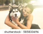 Smiling Young Woman Hugging A...