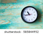 Black Clock On Wooden Table ...