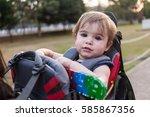 baby girl in carrying backpack... | Shutterstock . vector #585867356