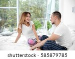 young couple together in bed | Shutterstock . vector #585879785