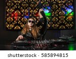 gymnast dj at the console does...   Shutterstock . vector #585894815