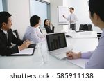 executives having a meeting in... | Shutterstock . vector #585911138