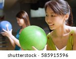 two women holding bowling balls ... | Shutterstock . vector #585915596