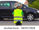 little boy riding a bike on the ... | Shutterstock . vector #585917828