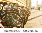 many bikes in a row on the... | Shutterstock . vector #585920846