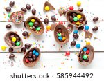 chocolate eggs on white wood... | Shutterstock . vector #585944492