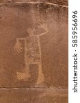 Small photo of A petroglyph image of the Wolfman on the cliffs of Butler Wash in the Comb Ridge aea of the new Bears Ears National Monument.